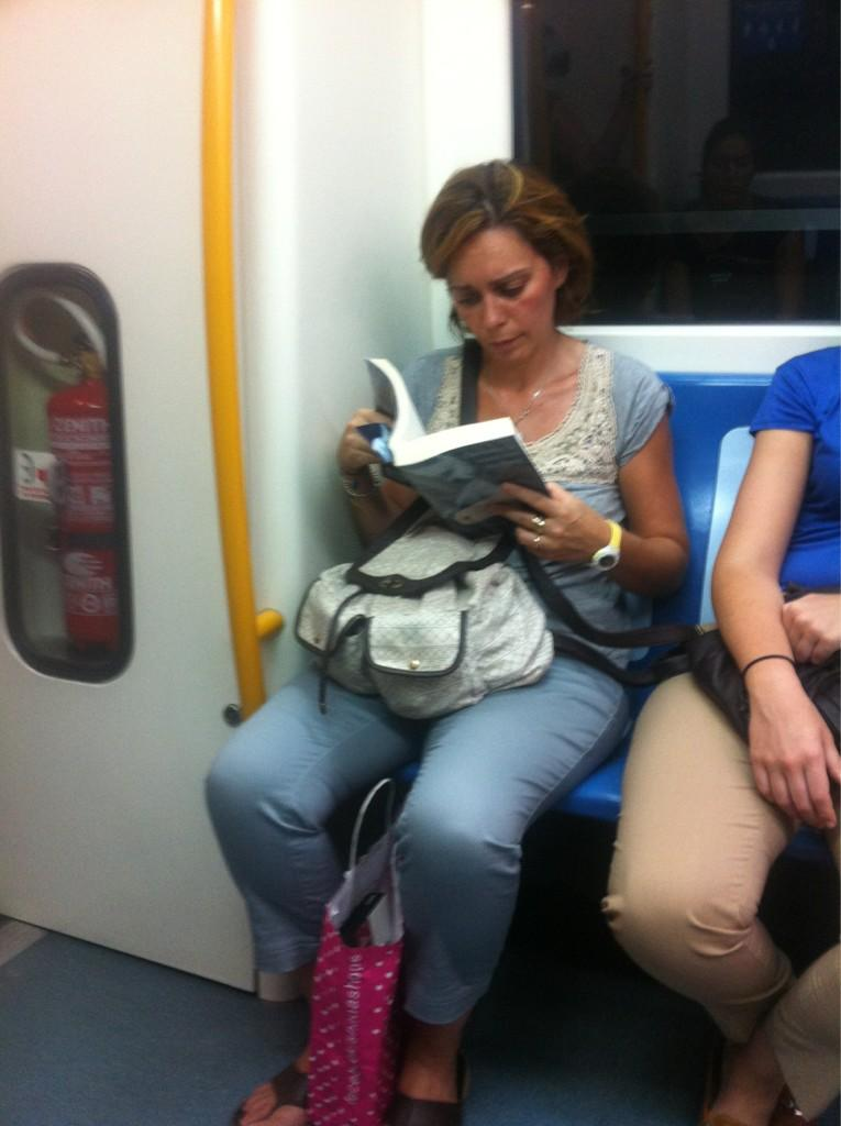 This woman was reading 50 shades of grey. Her book was wrapped in transparent plastic paper. Funny. http://t.co/JgFQJSW8