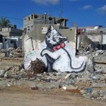 Banksy creates street art in Gaza criticising worlds largest open-air prison http://t.co/H9rM4ZvkfR http://t.co/7stK8v9slu