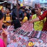 RT @kathmandupost: People buy Nepali Dhaka Topi, traditionally worn during Bhai Tika, in the Capital. http://t.co/JDfvjI6Adk
