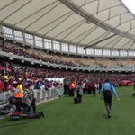Soccer fans are still coming into the Moses Mabhida stadium for the funeral service of #SenzoMiyewa #sabcnews http://t.co/jGIsdMRJ3D