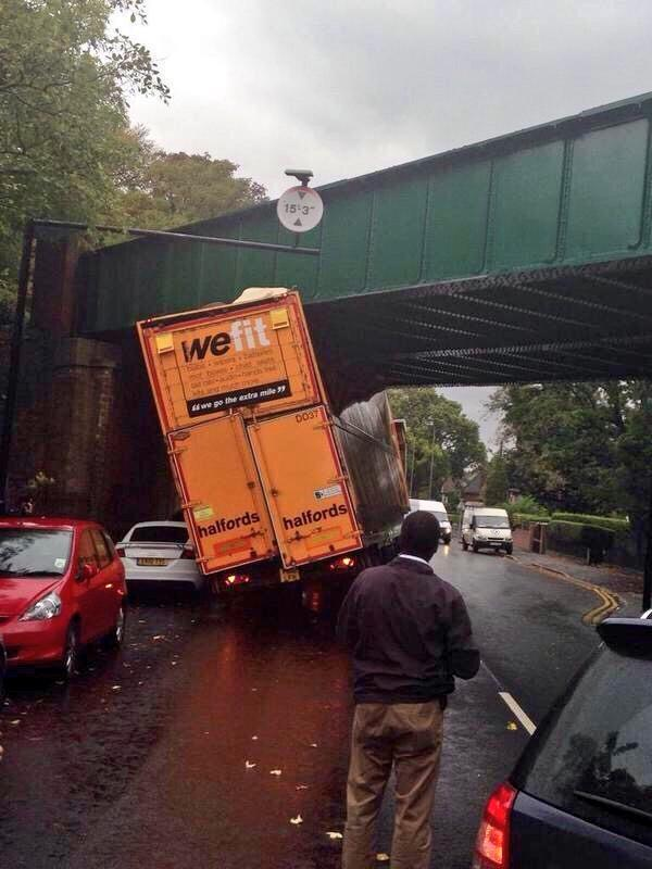 Halfords 'We Fit' lorry gets stuck under bridge http://t.co/APV8xyE0IP