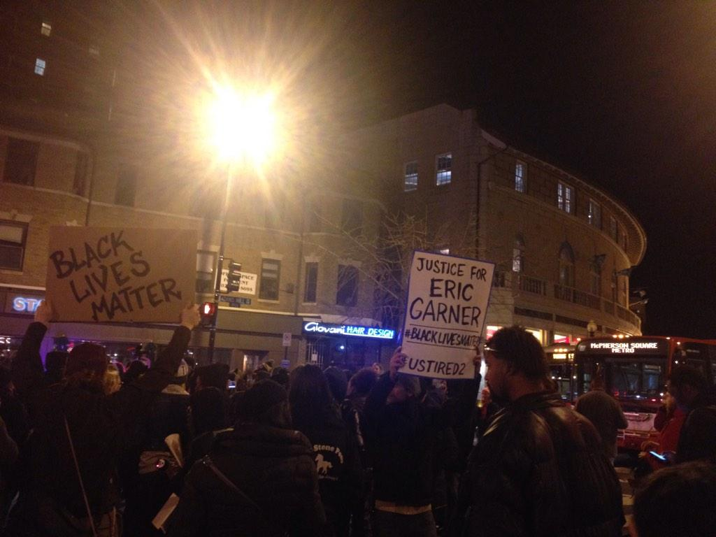 Protesters blocking DC intersection to protest non-indictment in #Garner case. Protest is peaceful. Cops standing by http://t.co/j0JSd9B62O