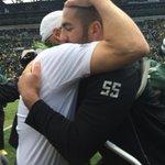 A tearful hug between senior center Hroniss Grasu and Mark Helfrich #goducks #seniorday http://t.co/ROYilKFoAF