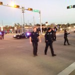 Police direct traffic as protesters move through intersection http://t.co/87I7OpOvrK