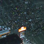 Protesters sitting down at Figueroa/Adams. Watch live: http://t.co/cFC1TOhKxM http://t.co/wLhLGhsATn