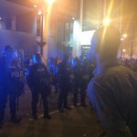 Police in riot gear stream out of a waiting MARTA bus in a tense confrontation with #ATLFerguson crowd. http://t.co/mGiZQOWdiR