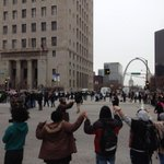 Protestors hold hands in silence.  Erie quiet in heart of downtown St. Louis. http://t.co/qxBlbxwNzM