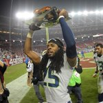 Richard Sherman carries the Thanksgiving turkey off the field like a trophy! http://t.co/2s7E1Z2MnA