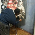 "Artist Xavier Jones is working on his painting, "" Flipper Breaking the Chains"" throughout #TEDxAugusta http://t.co/quTf5WYifQ"