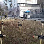Crosses with names of those killed in Mariupol attack, in front of the Russian embassy in Kyiv. Strong message. http://t.co/WkGPUqMTE3