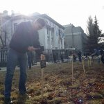 Ukrainians plant mock graves inscribed with the dead from Mariupol Grad attack outside the Russian embassy in Kiev http://t.co/GtLZlPBQjI