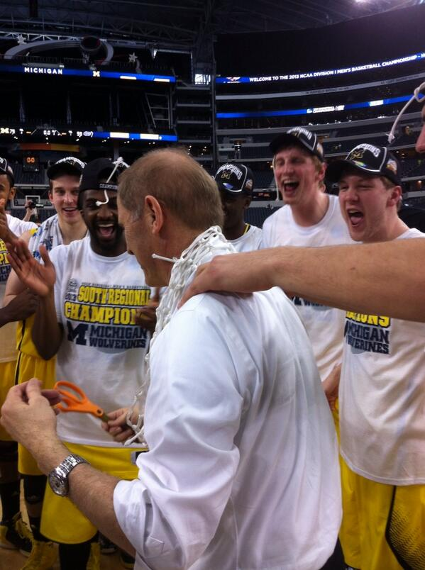 Coach Beilein with the net around his neck. Epic http://t.co/JM2t2Yaypp