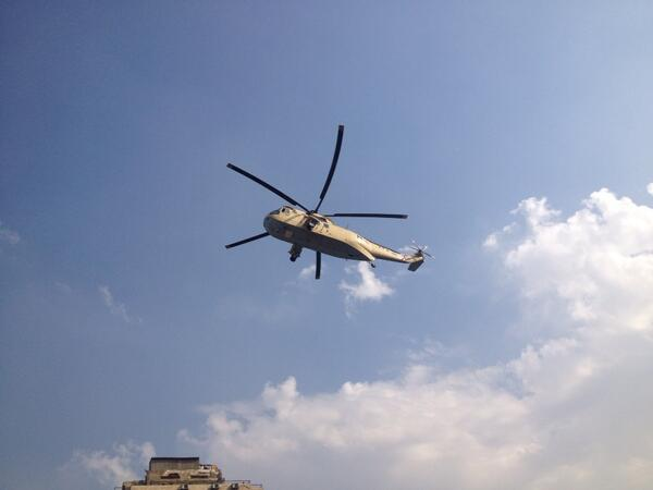 The military, flying low over Cairo, radio blasting nationalist songs, & billboards telling ppl vote yes. http://t.co/ZnakbgxbLh