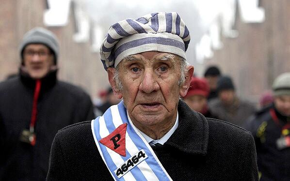 A Holocaust survivor before a ceremony to mark the 69th anniversary of the liberation of Auschwitz http://t.co/pJAsqLxlXK