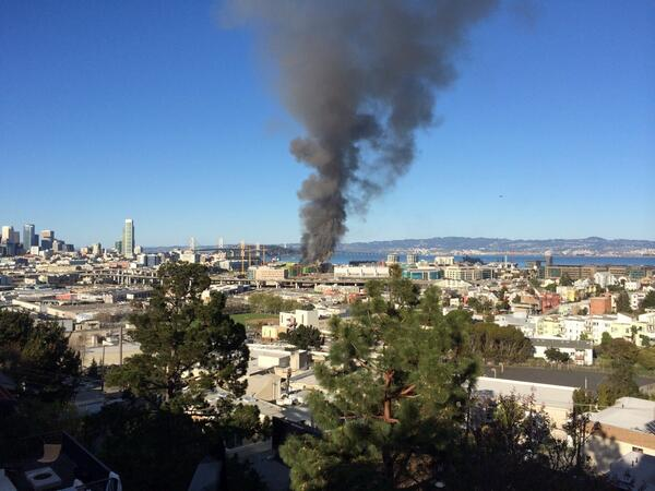 Looks like a huge fire in one of the under construction buildings at Mission Bay http://t.co/oukKuVetZR