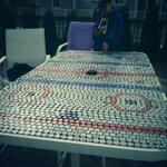 Table made out of beer bottle caps #BecauseItsTheCup @Buccigross http://t.co/AJne4tKk9L