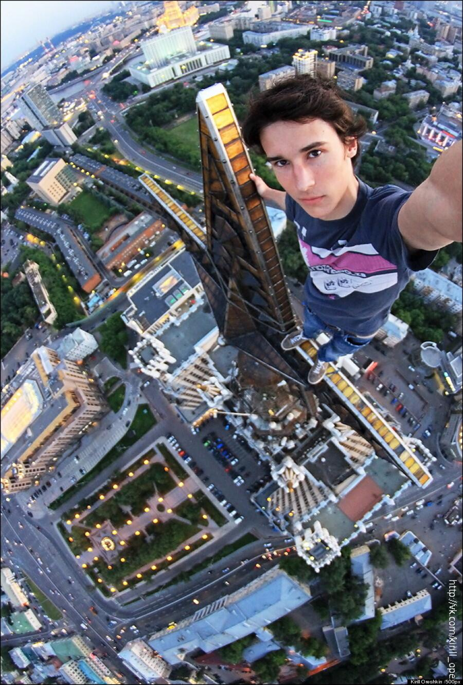 Russian daredevil takes insane selfie dangling from the top of high-rise building: http://t.co/HIZIpTo7Wk