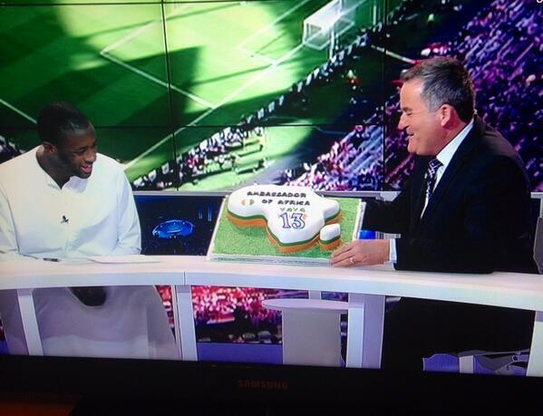 Boa72RJCQAAFZaI Man City midfielder Yaya Toure given birthday cake by Richard Keys live on BeIN Sports!