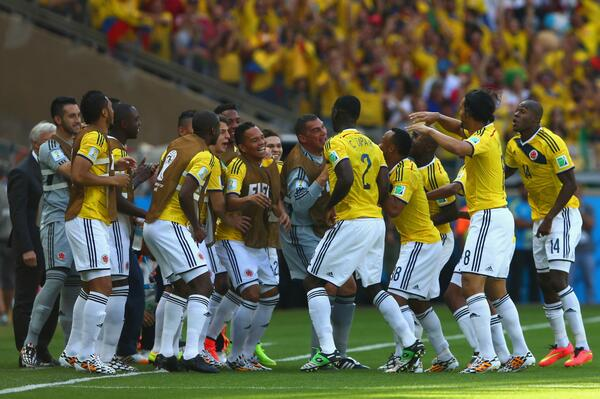 Colombia players celebrate first goal [via @FIFAWorldCup]