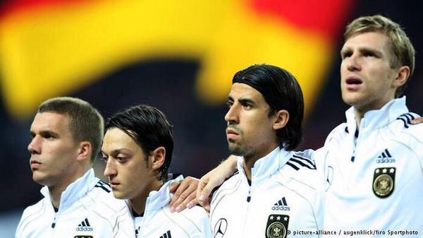 BslcV79IEAAPOX8 Lukas Podolski shouts Arsenal when Sami Khedira is asked who he will play for next season