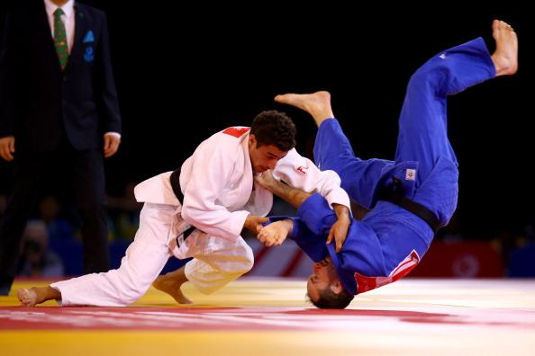 Ashley McKenzie wins #Glasgow2014 judo gold for England in the -60kg category. Watch finals live on @bbcthree http://t.co/LHGEGmvRso