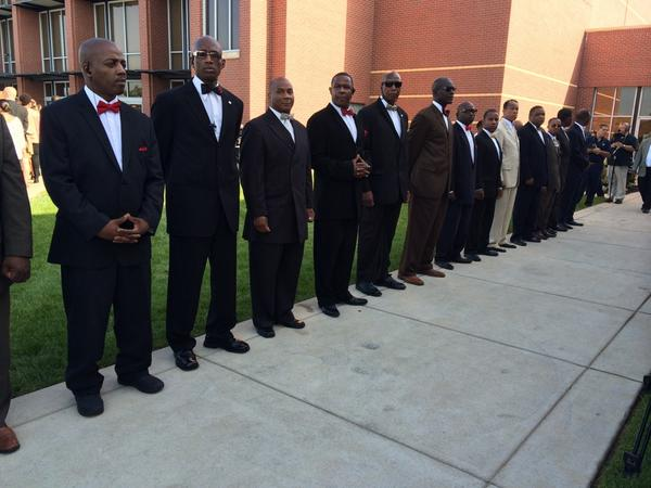 Nation of Islam lined up waiting for the arrival of @LouisFarrakhan at funeral of #MikeBrown  #Ferguson http://t.co/Li7LrAn743