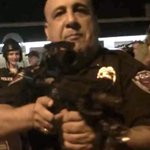 More madness in #Ferguson Officer threatens protestors with rifle refuses to identify himself http://t.co/B69HH2UXRR http://t.co/Fe4MDq3NgJ""