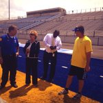 Jason Harris, @TupeloHigh principal, & THS football coach Trent Hammond show State Supt. Carey Wright the blue turf http://t.co/cYtYG4kv5y