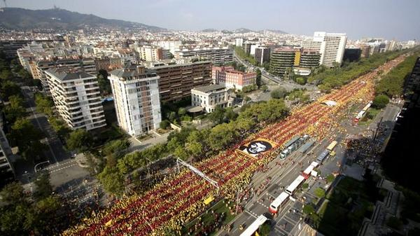 "police says we were 1,8 million people, we did a gigantic V (for ""V""ote), each leg was a Catalan flag made of people http://t.co/Ssl9wISRbb"