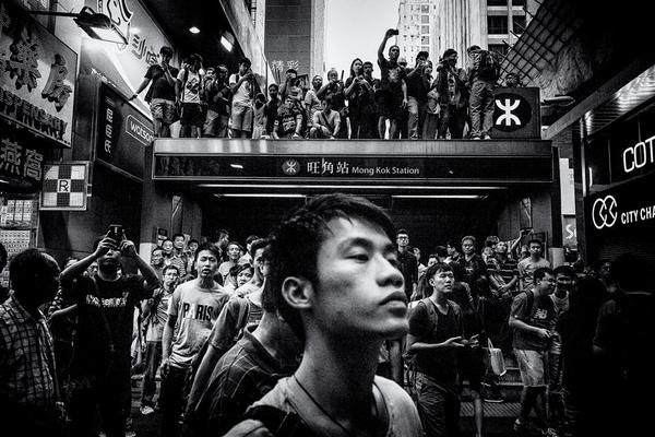 This photo by @f8photographyhk outside Mongkok's subway station says Mongkok like nothing I've seen - #HongKong http://t.co/O7cGb5GELw
