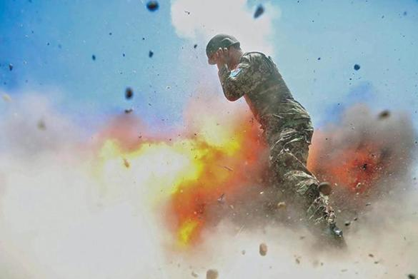 Army combat photographer snapped one last picture - seconds before an explosion killed her