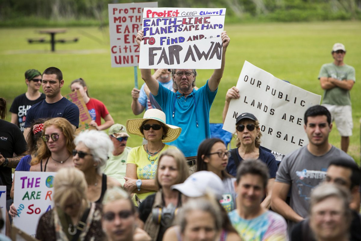 Hundreds of Houstonians protest climate change on Trump's 100th day
