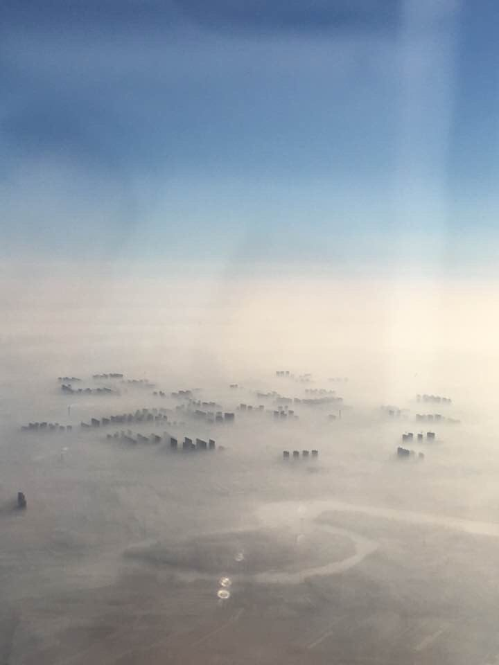Beijing from the air as smog blankets the city. Just otherworldly - and alarming https://t.co/P8oTLRFomR