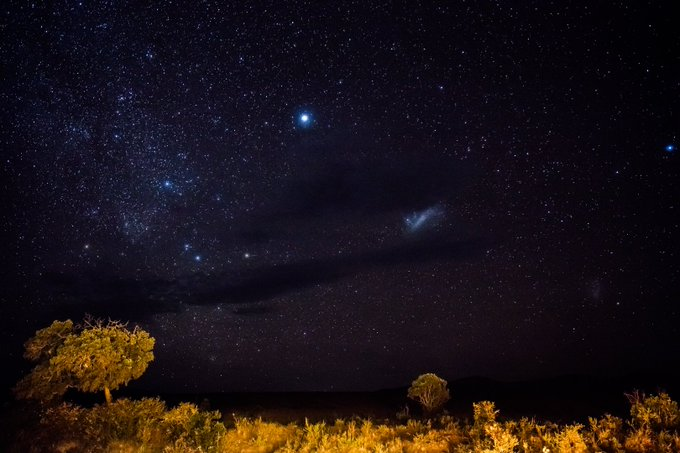 yup. this is Kenya at night.  No filter, no photoshop. just a long exposure. Yes, that is a galaxy in there.