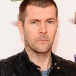 Comedian Rhod Gilbert suffered a 'suspected mini stroke' while sitting on the toilet