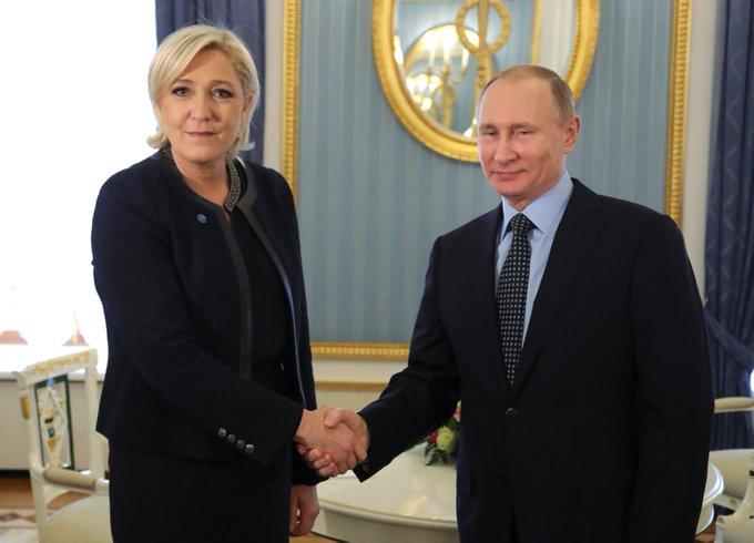 BFFs? France's far-right Marine Le Pen met Russian President Vladimir Putin in Moscow.