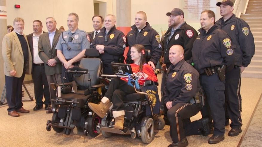 University rallies to present disabled honor student with new high-tech wheelchair