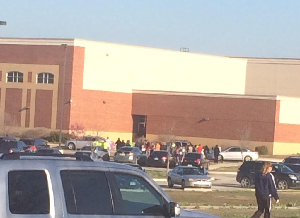 Crowd of parents gathering at Tidwell Middle School to protest a student being let back into school. http://t.co/7tshyGc0zh