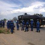 Riot police disperse several hundred protestors in nyakabigai neighbourhood #bujumbura #burundi http://t.co/jGz3HEZpZ4