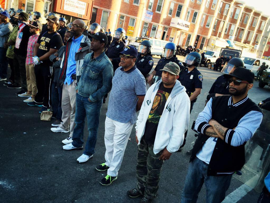Wow. RT @CeeJayCraig: This is powerful. Citizens are lining up to protect the police. #Baltimore http://t.co/WpYq8RVK2c