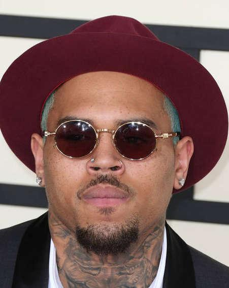 Chris Brown outs naked intruder with Instagram photo