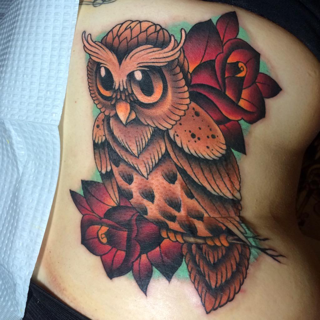 Cute owl head tattoo