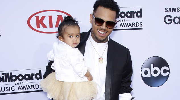 Chris Brown brings baby daughter to the billboardawards - how cute is she??