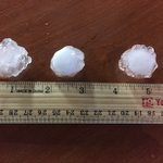 """Hail at the WXOW Studio between an inch and 1.50"""" (quarter up to ping pong balls) and hail covered parking lot http://t.co/qbEH78HdUh"""