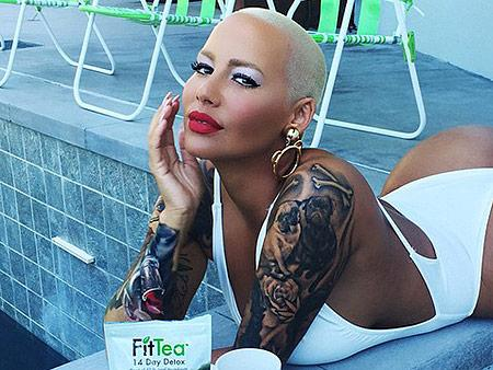 Amber Rose shows off her buns in revealing swimsuit pics