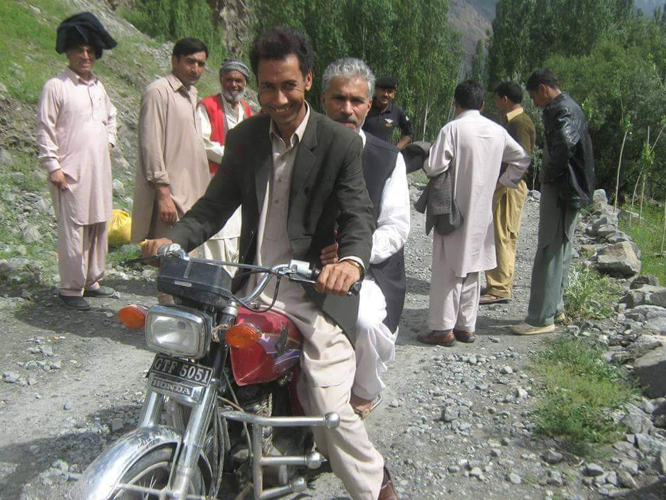 Minister Information Ibrahim Sanai sitting behind on the bike visits area after floods hit remote Ghanche district. http://t.co/xmCzFSkVwg