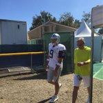 .@tonyromo entering the field for the first padded practice of 2015 #CowboysCamp http://t.co/9RJxoApfzH