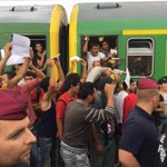 Refugees shouting dont leave us as media pushed away from train http://t.co/Mgo7RXJhpb