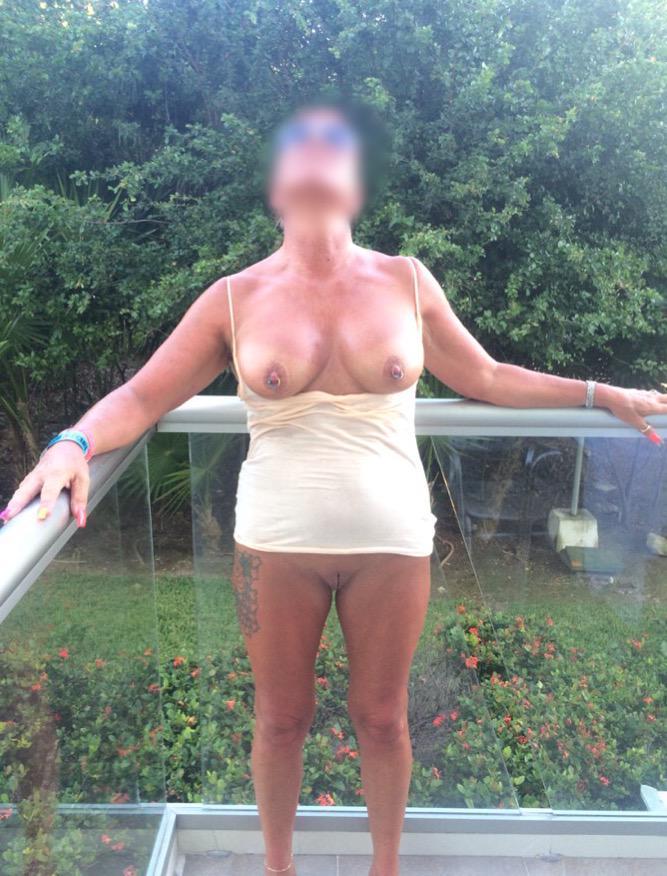 Amateur wife flashing pussy on hotel balcony