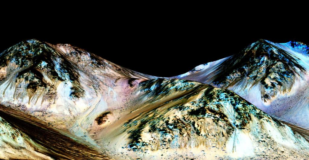 Liquid water spotted flowing on Mars. And Curiosity isn't far away http://t.co/UDQFk0mx3w http://t.co/0sQ4wKkV4Q